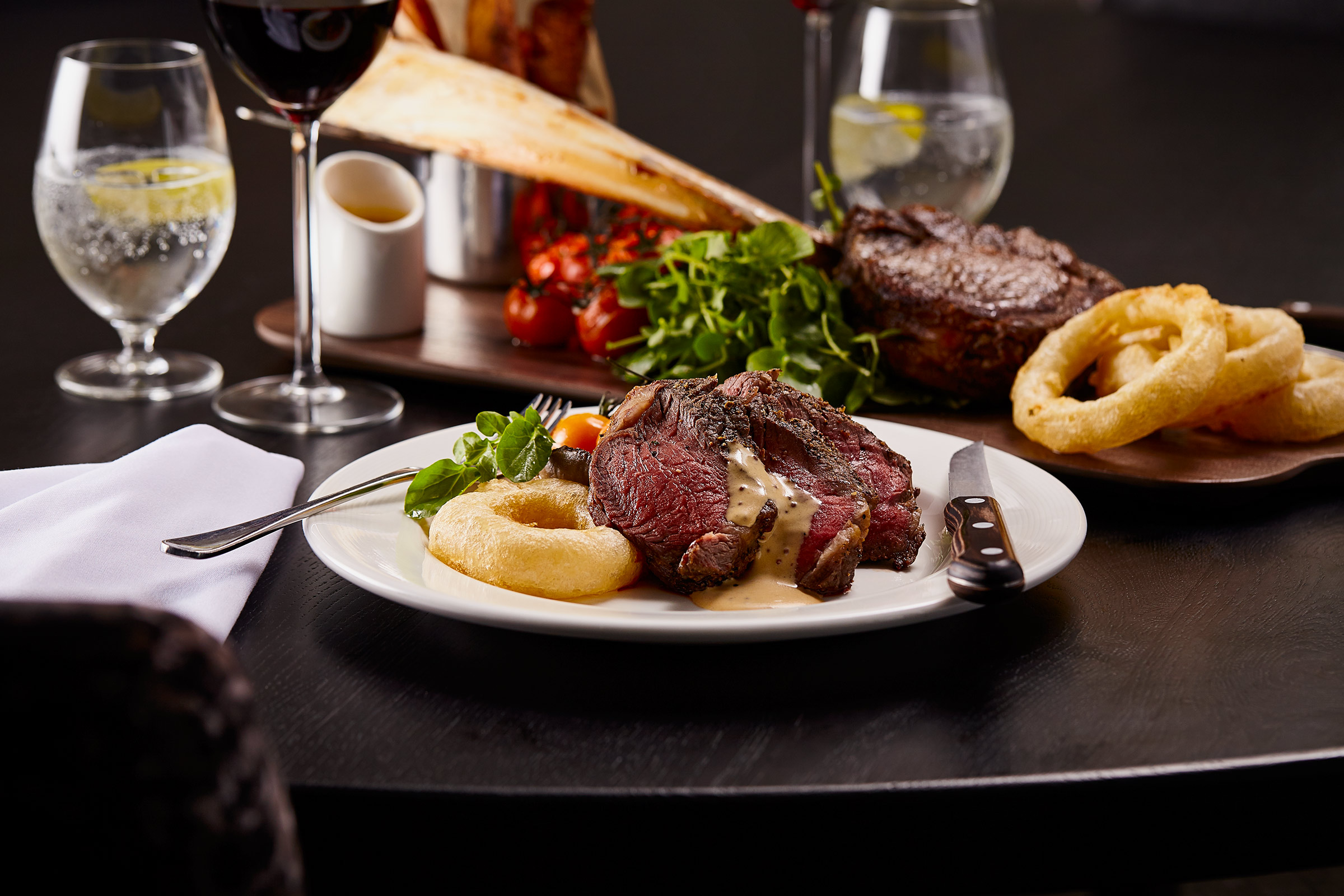 Tomahawk Steak, pepper sauce and onion rings, Scotts restaurant, Glasgow food photographer